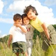 Happy three children in nature — Stock Photo #21443415