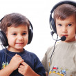 Two cute boys with headphones on — Stock Photo