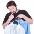 Confused male model between two shirts — Stock Photo