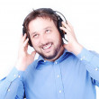 Stock Photo: Young young beautiful man with headphones