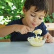 Stock Photo: Cute little kid eating ice cream and enjoying