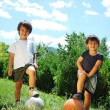 Two little kids with basketball and football — Stock Photo