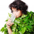 Nice little girl in leafs cloths drinking water — Stock Photo