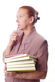 Aged female student with books — Stock Photo