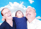 Happy family, grandfather, grandmother and grandson — Stock Photo