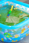 Dirty little plastic pool — Stock Photo