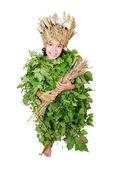 Meisje in leafs doeken met tarwe hoed en tarwe in handen — Stockfoto