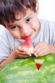 Very cute kid eating watermelon — Stock Photo