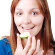 Nice girl about to eat a cucumber — Stock Photo