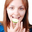 Nice girl about to eat a cucumber — Stock Photo #21457857