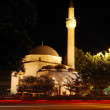 Mosque, crescent and star, traffic and lights at night — Stock Photo #21458437