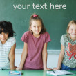 Classroom at school and text on green board — Stock Photo