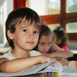 Stock Photo: Pupil activities in the classroom at school