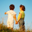 Romantic vision of two children standing together outdoor — Stock Photo