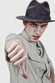 Young model with thumb down — Stock Photo