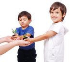 Little cute children holding green plant in hands — Stock Photo