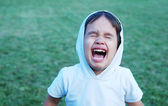 Little kid screaming with wideli opened mouth — Zdjęcie stockowe