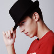 Young male model with hat from profile — Stock Photo #21461123