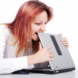 Girl biting laptop — Stock Photo #21461965