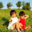Little cute children on beautiful green field — Stock Photo