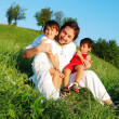 Young father in white with children on beautiful meadow — 图库照片