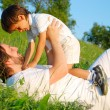 Young father in white with child on beautiful meadow — Stock Photo #21464941