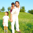 Young father in white with boys on beautiful meadow — Stock Photo #21465043