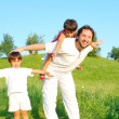 Young father in white with boys on beautiful meadow — Stock Photo #21465067