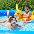 Children activities on swiming pool in summer — Stock Photo #21465277
