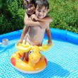 Children activities on swiming pool in summer — Stock Photo #21465535