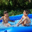 Children activities on swiming pool in summer — Stock Photo