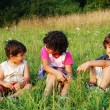 Stock Photo: Happy little children in grass on meadow