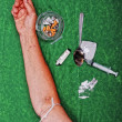 Drugs addict activities and some tools on table — Stock Photo
