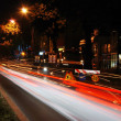 Stock Photo: Colorful scene of traffic at night and workin arebeside