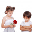Beautiful scene of angry boy and girl with rose — Stock Photo #21466875
