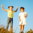Stock Photo: Happy little girl and kid jumping and joying in nature
