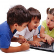 Stock Photo: Chidren activities on laptop isolated in white