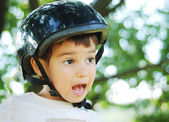 Cute kid with helmet on his head — Stock Photo