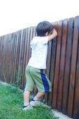 Kid is playing in garden — Stock Photo