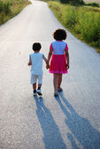 Brother and sister walking — Stock Photo