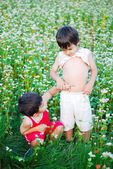 Two little brothers standing outdoor — Foto Stock