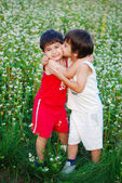 Two little brothers kissing each other — Stock Photo