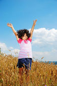 A little pretty girl on wheat field — Stock Photo