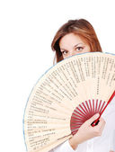 Female model with fan in front of her — Stock Photo