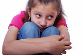 Litlle cute girl on ground with emotional expression — Stock Photo