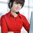 Beautiful customer support girl in front of laptop in an office — Stock Photo #21478033