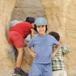 Summer tourist vacation, children playing around the little cave — Stock Photo