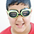 Happy funny cute boy with the pool swimming goggles — Stock Photo