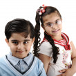 Stock Photo: Two children, brother and sister, isolated on white, mixed race