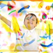 Happy child with thumbs up in colors, space, room — Stock Photo